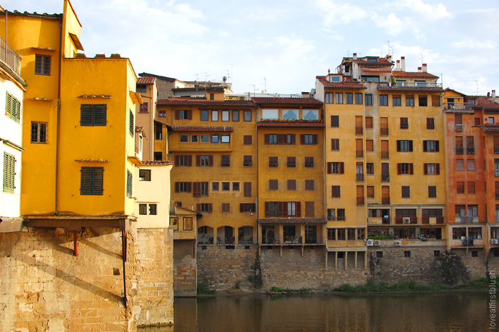 yellow buildings in florence on the st arno