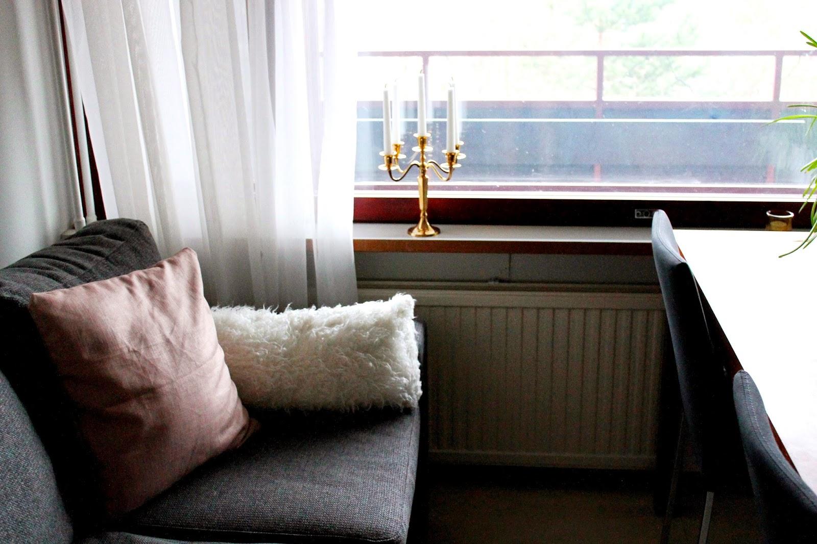 New pillowcase on the couch   Alinan kotona blog #pillowmakeover #pillowcase #home #decor #DIY #couch #candles #gold