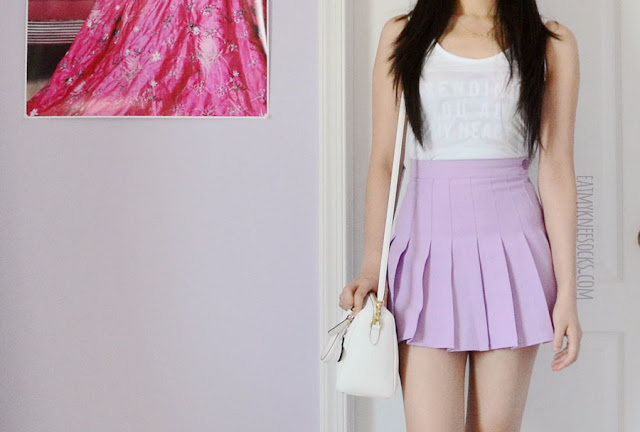 More photos of the Snapmade custom-print tank top that I created, modeled with an American Apparel dupe pleated tennis skirt in lavender and a white Coach purse.
