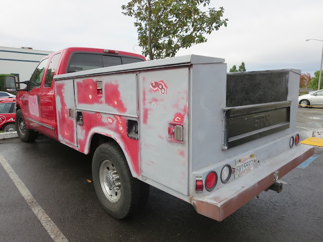 Used and abused work truck in need of fresh paint at Almost Everything Auto Body