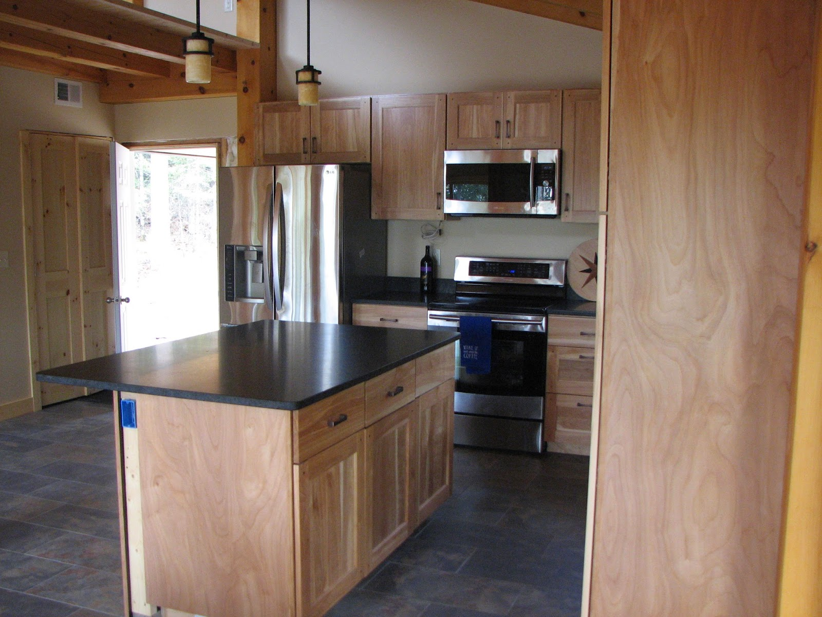honed, mesabi, black, granite, red birch, cabinets, timber frame, huisman