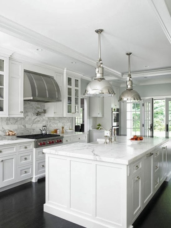 white kitchen with chrome finishes and marble