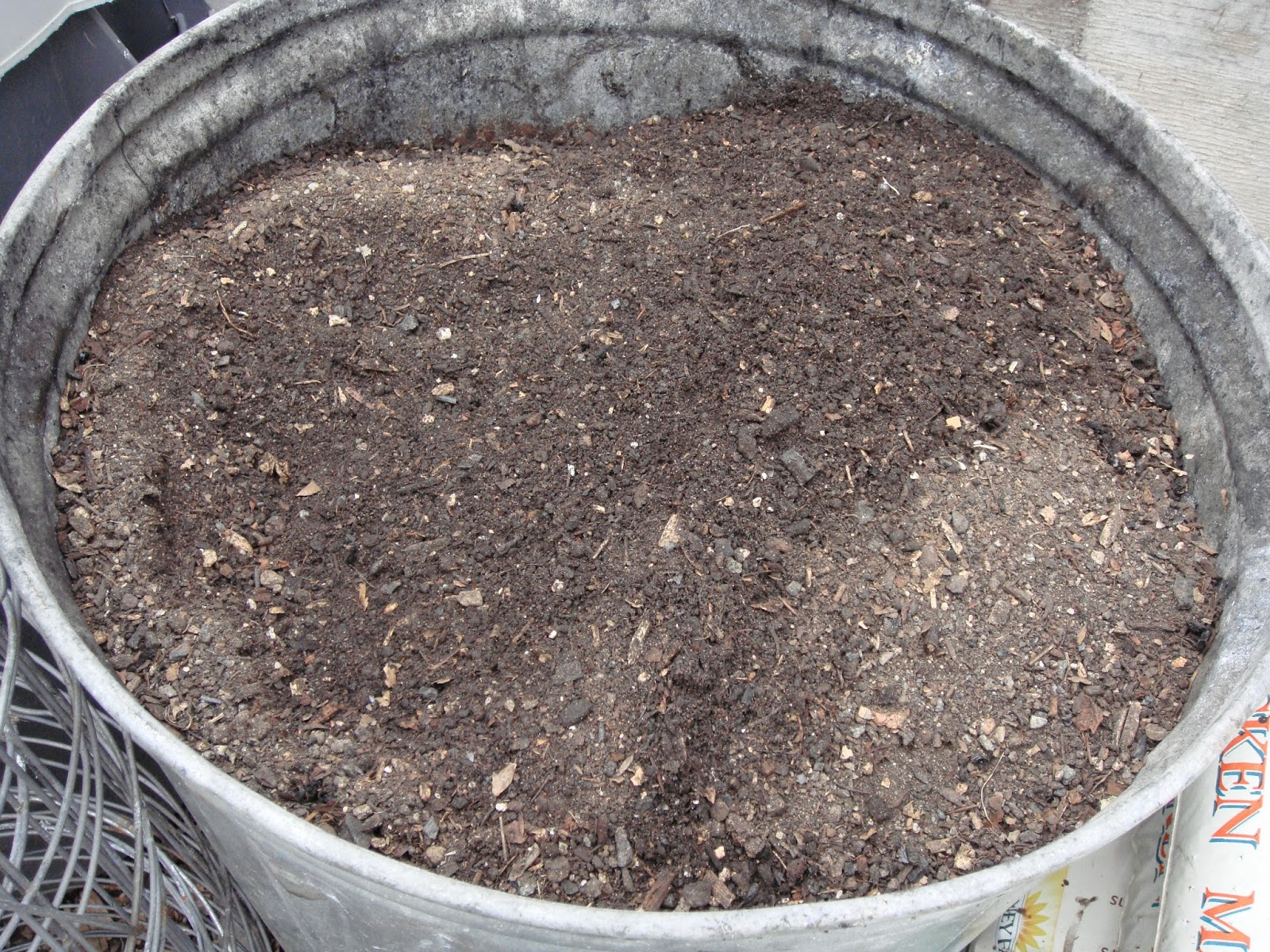 Finished and Screened Compost From Bottom Of Last Pile, Black Gold!  In This Shot I've Taken the Oldest and Most Decomposed Compost and Screened it off Through my Compost Mill, Then Put it in Galvanized Storage Bins (Trash Cans) for Later Use in the Garden Beds or in Making Custom Mixed Potting Soil.