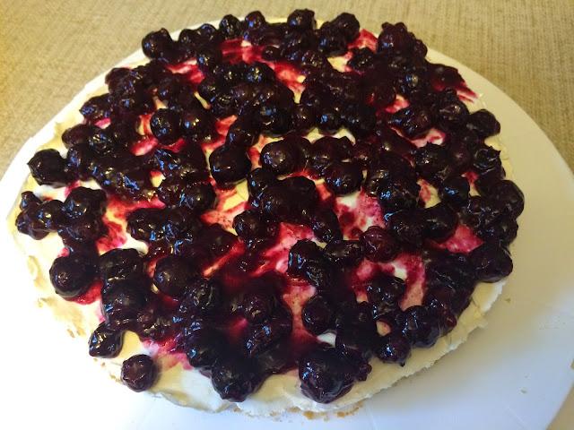 vanilla no-bake cheesecake with blueberry lemon sauce