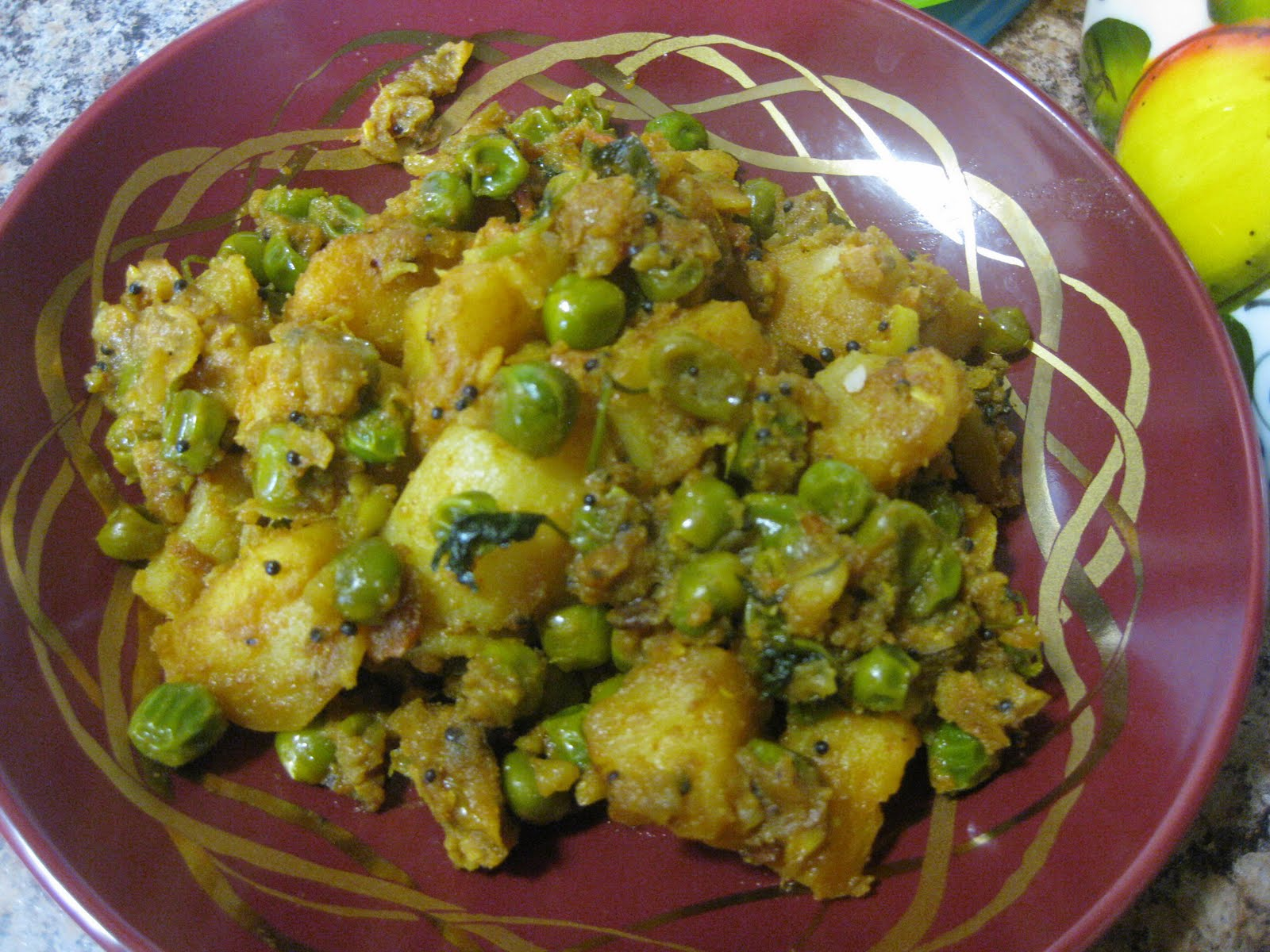 Spicy potato and peas curry ~ NalinisKitchen