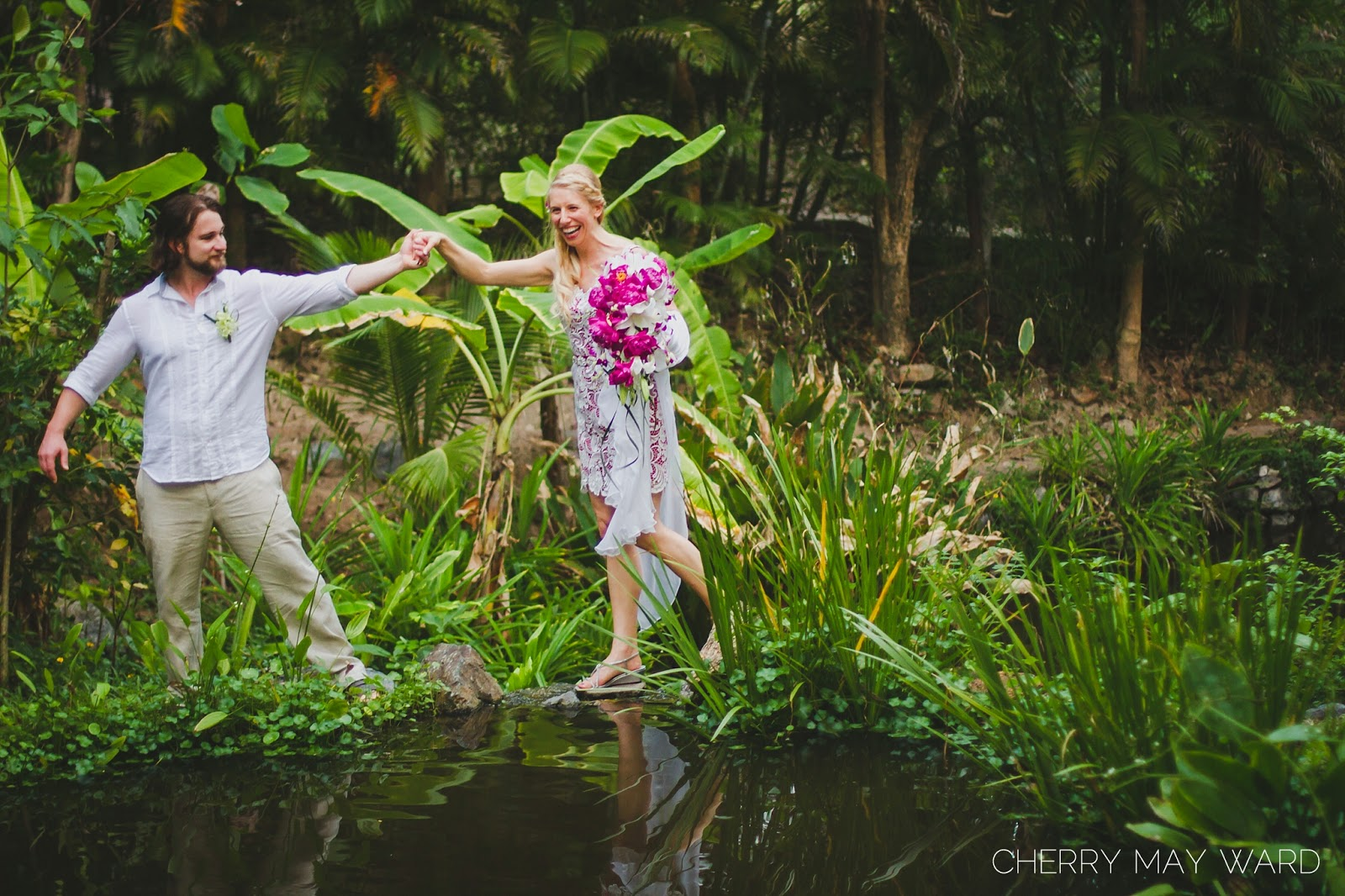 fun bride and groom, bride and groom walking in thai gardens, water ponds in Thai garden, beautiful bride and groom photos, Koh Samui villa wedding
