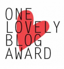 One Lovely Blog Award badge.