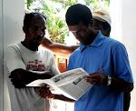 Pescadores lendo O SAMBURÁ