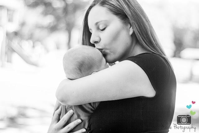 mom kissing baby's forehead