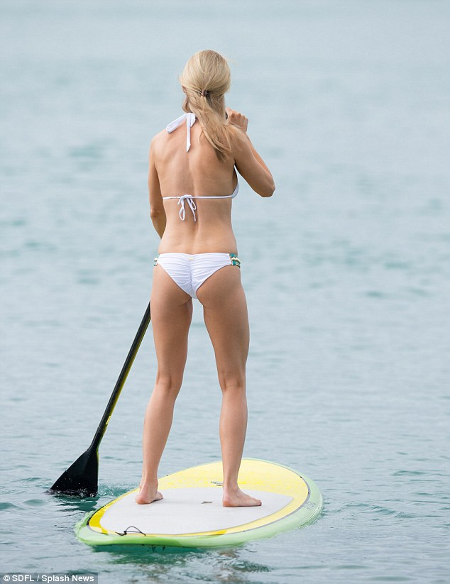 Joanna Krupa shows off a bejewelled bikini as she paddle ...