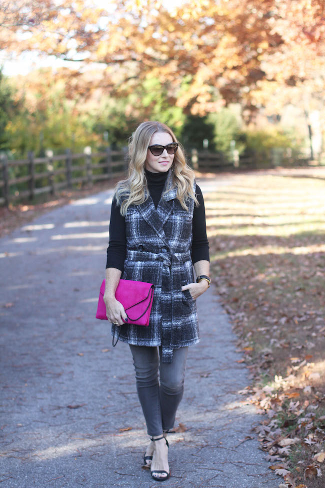 halogen turtleneck, wool vest, grey jeans, cat eye sunglasses, pink clutch