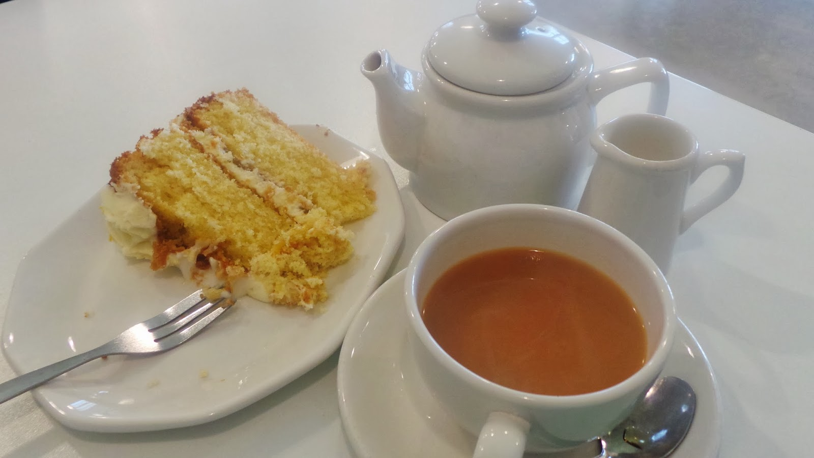 lemon cake with pot of tea