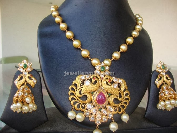 pearl chain with gold antique pendent