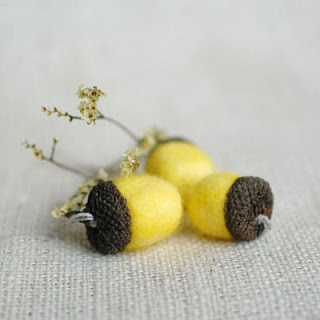yellow felted wool acorns