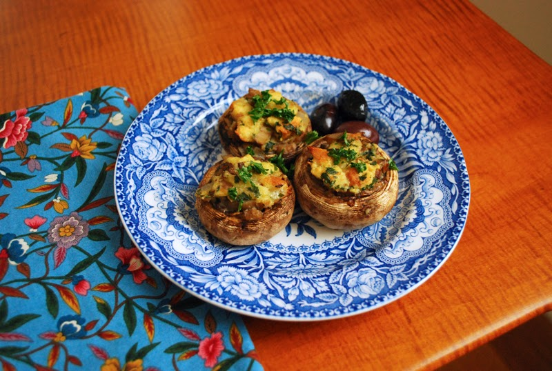 stuffed mushrooms on fancy blue plate