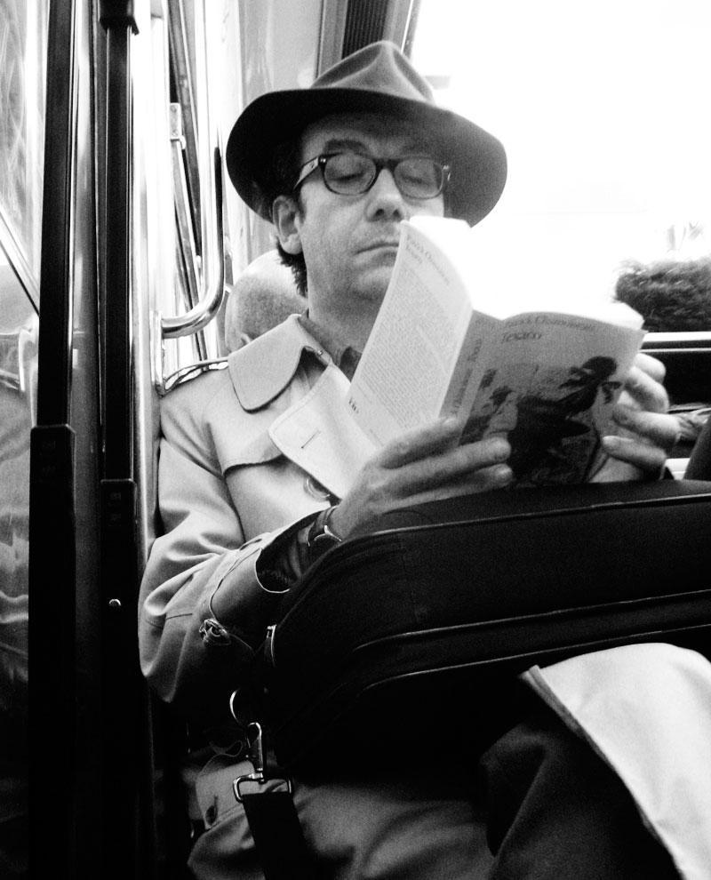 Reading on the Metro; click for previous post