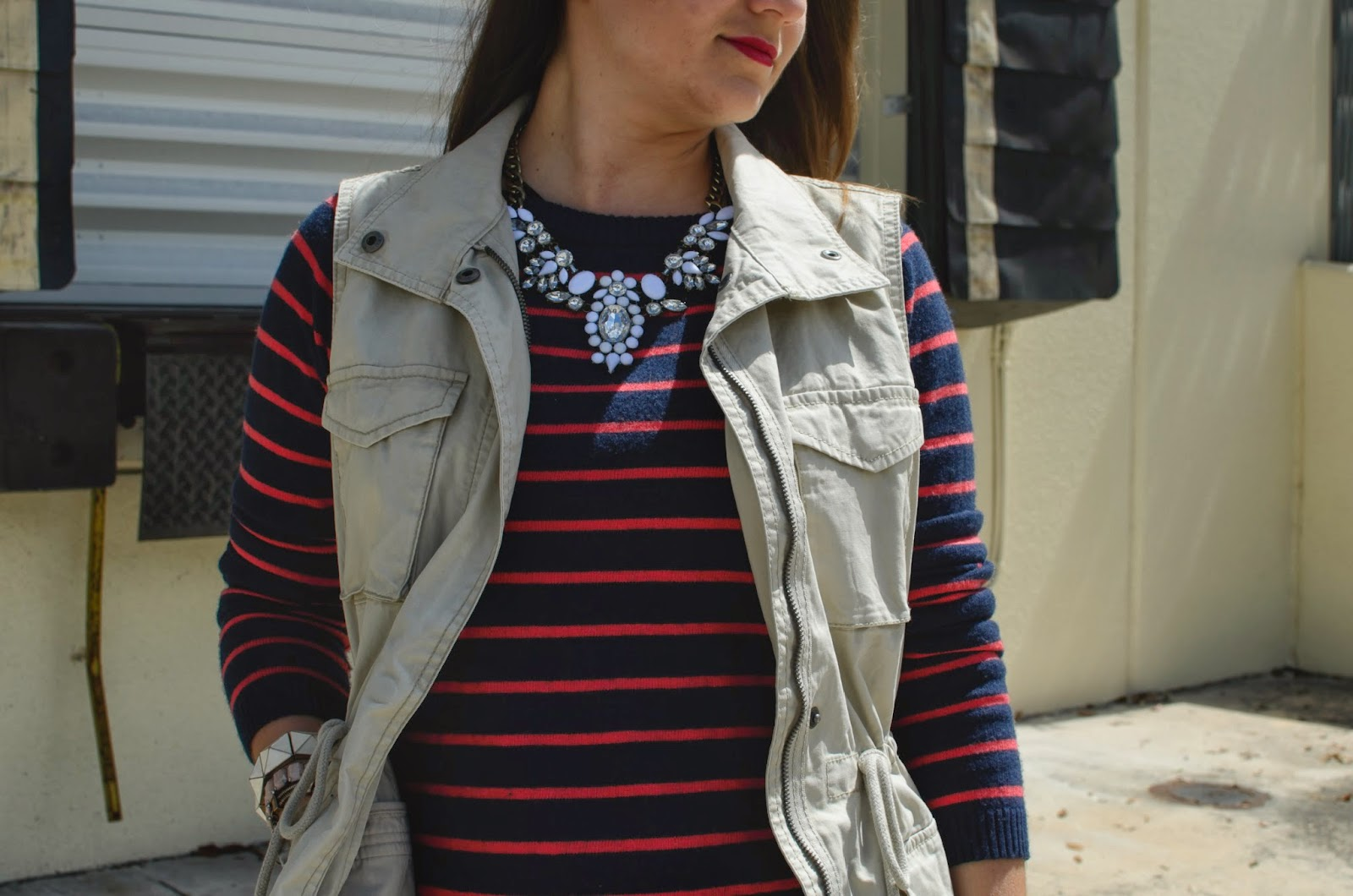 utility vest - statement necklace - stripped sweater