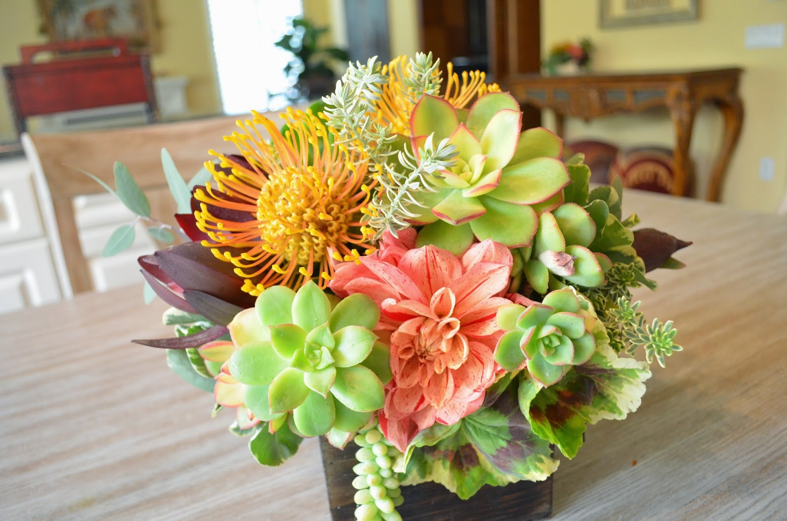 I am plying with my favorite combination pincushion proteas, succulents and  dahlias for my weekly arrangements around the house.