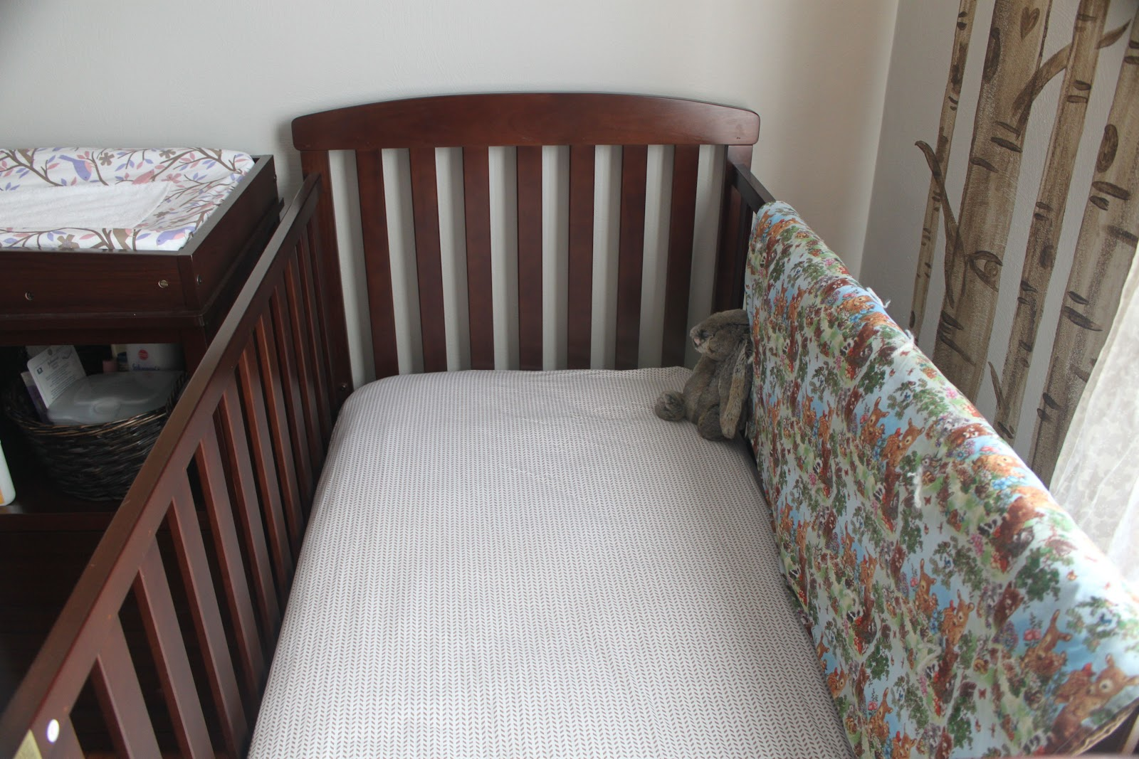 how to put a swinging crib together