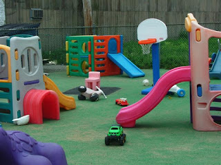 garden toys in an outdoor space with astroturf