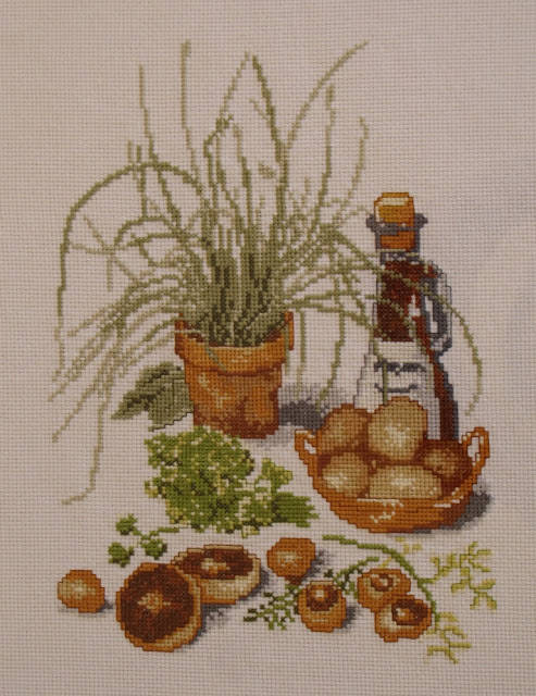 Cuadro de punto de cruz para la cocina con hierbas aromáticas, vinagre y champiñones