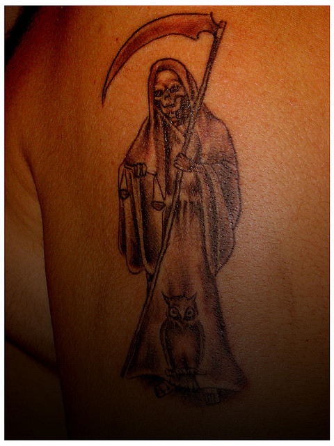 De la santa muerte tattoos pictures to pin on pinterest tattooskid - Santa muerte signification ...