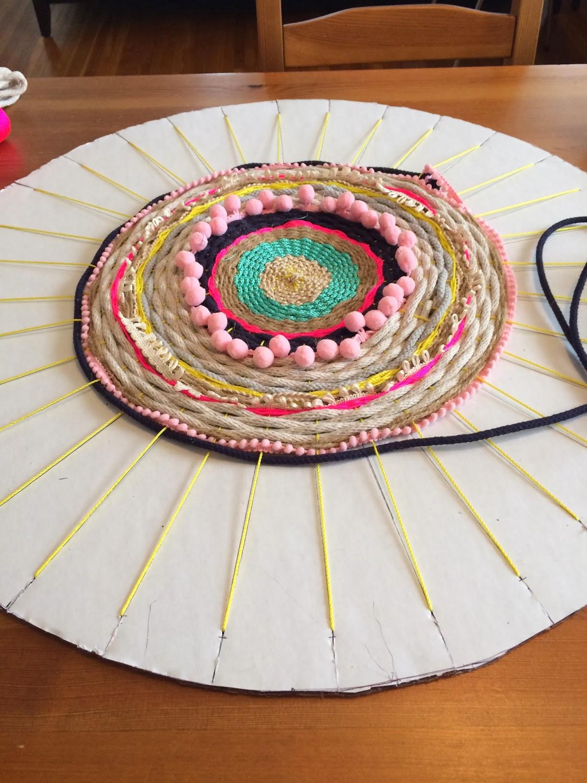 diy woven pom pom rope rug. Black Bedroom Furniture Sets. Home Design Ideas