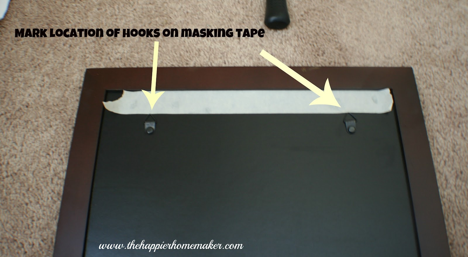 Decorated Stair Landing and Picture Hanging Tip | The Happier Homemaker