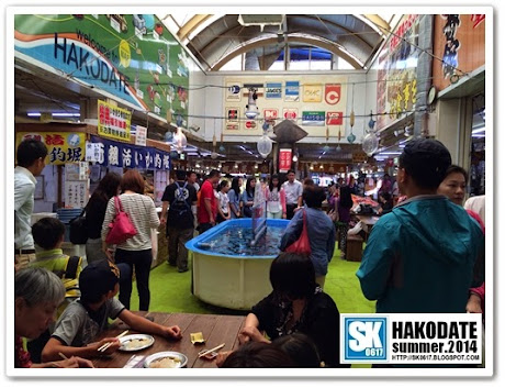 Hakodate Japan - Morning Market, catch squid yourself and have them eaten raw on the spot
