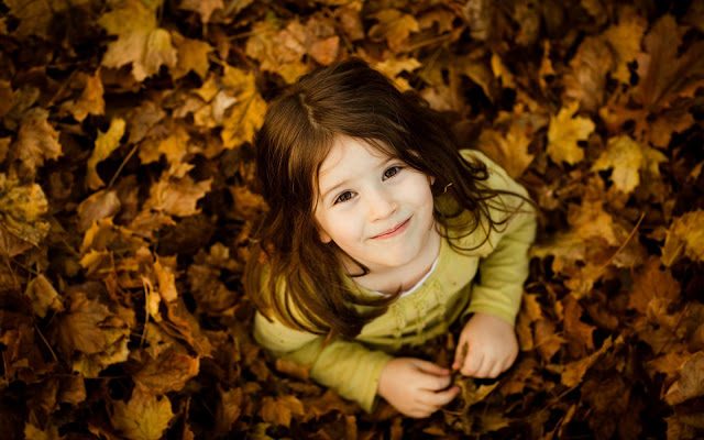 Cute Girl With Leaves