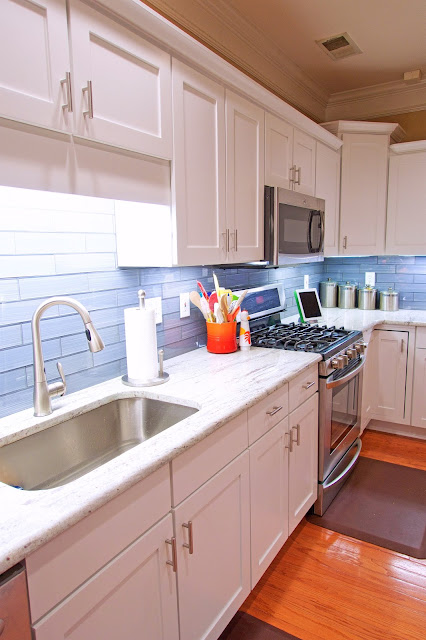 Before and After White Kitchen Renovation - painted cabinets, River White Granite, Datile Enchanting Impressions Paint Brush Glass Tile in Gray. We did it all for under $10K!