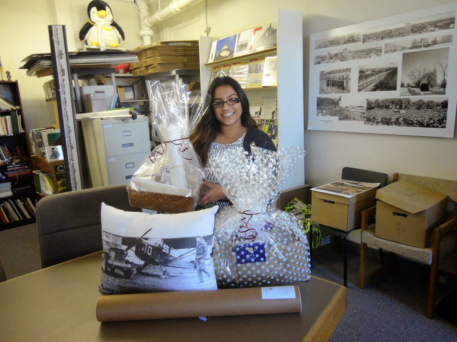 "Roshanie poses with the ""Explore the Exchange"" Membership Drive prize packs for August and September"