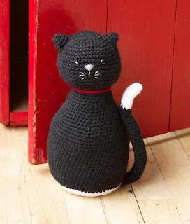 Crocheted black-cat doorstop from Lion Brand Yarn
