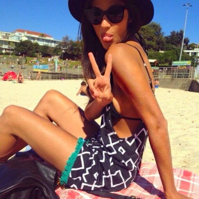 Pia Miller seemed very relaxed and happy in a black bikini and she was spotted soaking up the sun by the beach at Bondi beach in Australia on Thursday, September 11, 2014.