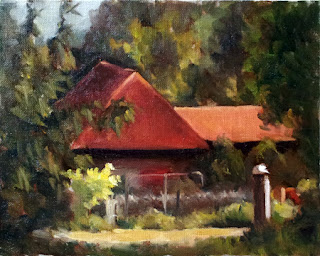 Oil painting of a steep-pitched red-rooved shed surrounded by trees and shrubs.