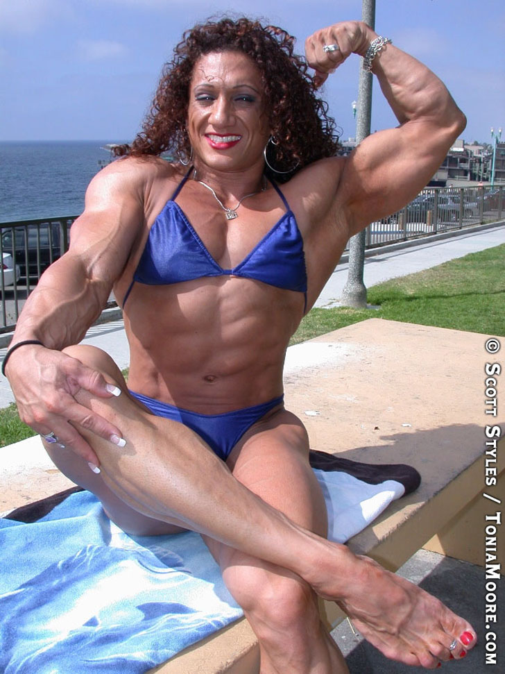 Tonia Moore Flexing A Bicep And Posing Her Ripped Physique