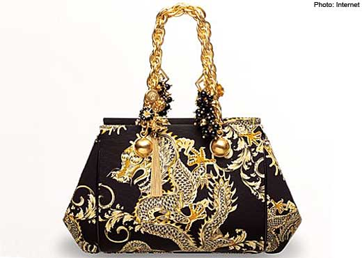 The Special Cny Collection Features Luxurious Handbags Featuring Golden Dragons On A Black Background With Matte Gold Accents Are Also Studded