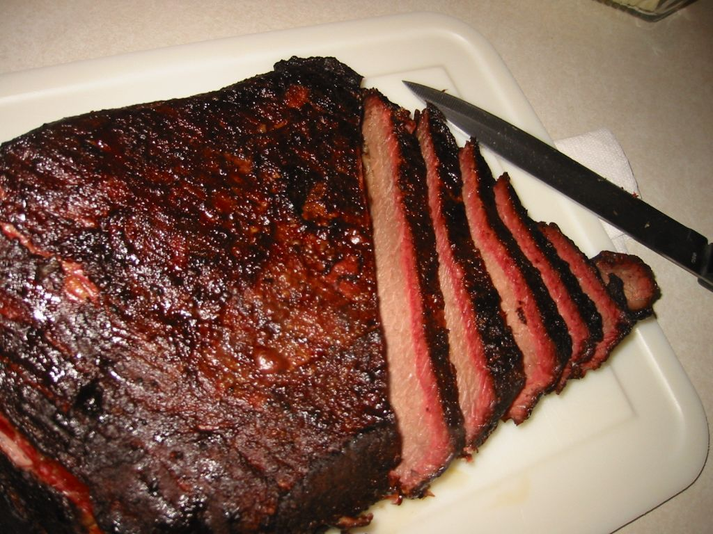 ... brisket as it cooks. Bar-B-Q sauces and other condiments are served on
