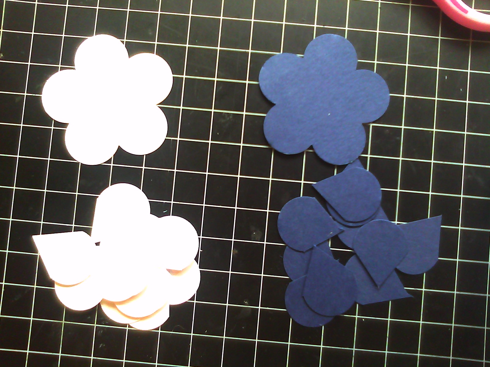 How to scrapbook flowers - After Punching Flowers In Your Chosen Colors Cut Each Petal To The Center An Separate