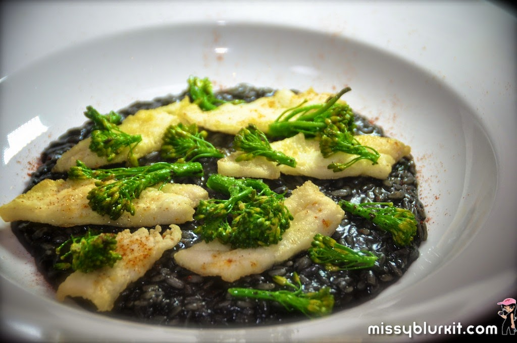 Squid ink risotto with broccoli and crispy cod chips RM32