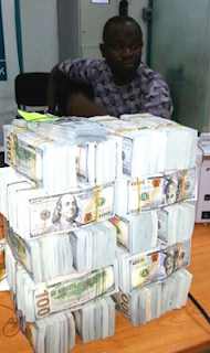Man arrested with fake $2.1million at Lagos airport(Photos)
