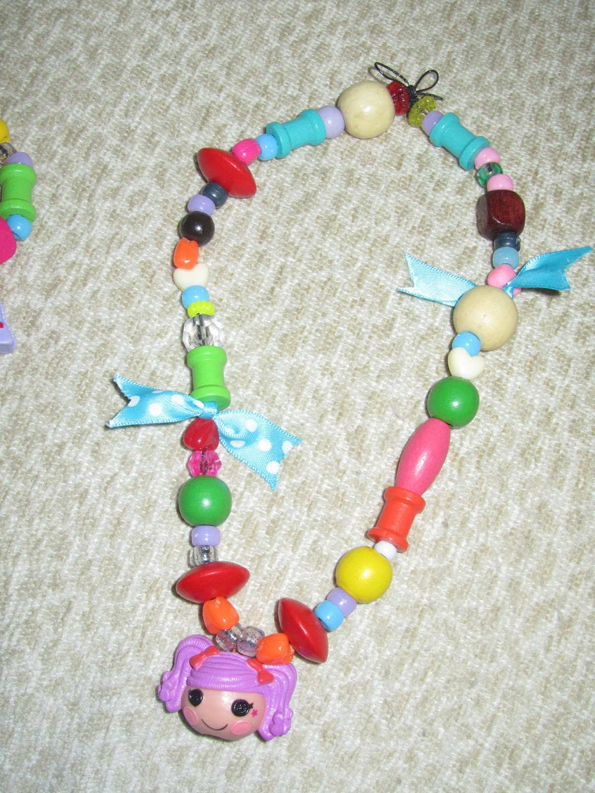 Click on the link to find out how to make the Lalaloopsy necklaces