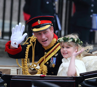 Prince Harry and bridesmaid Lady Louise Windsor depart the Royal Wedding in a carriage.