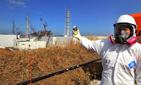 A journalist checks radiation levels at stricken Fukushima Dai-ichi nuclear power plant. The 2011 disaster, which will cost Japan over $100 billion, set back the nuclear industry worldwide. (Photo Credit: AP) Click to Enlarge.
