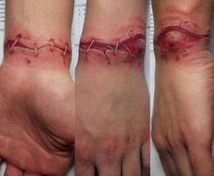 Realistic wound tattoo on wrist