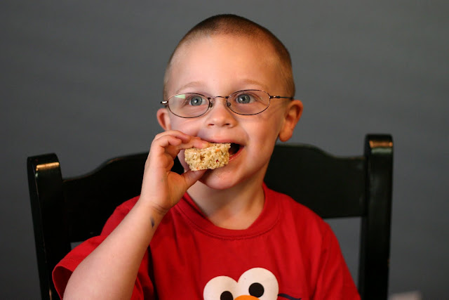 Child smiling while eating a treat