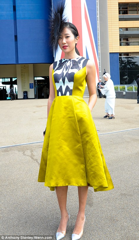 elegant women in mustard yellow dress on Ladies' Day of Royal Ascot 2014