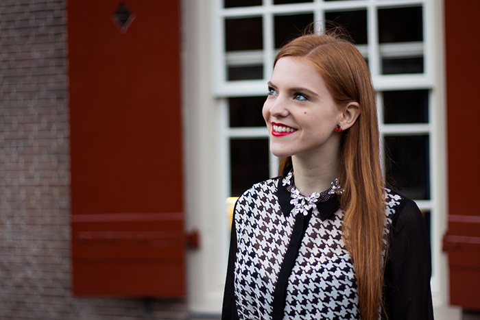 Chic vintage blogger outfit with a houndstooth blouse and statement necklace