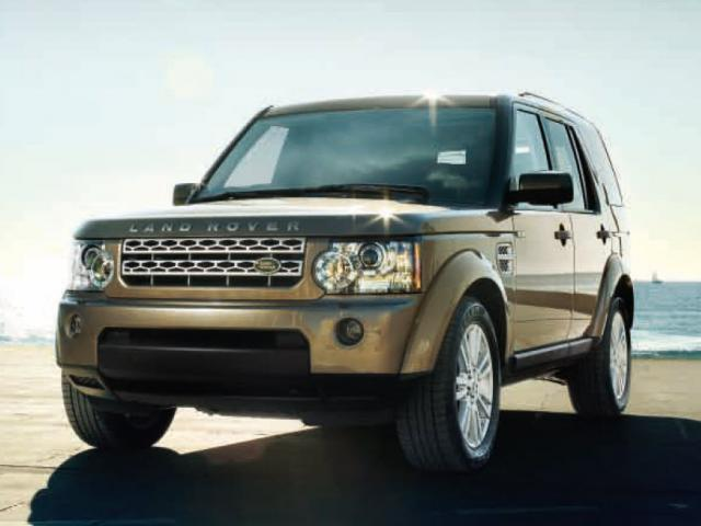 Front 3/4 view of bronze 2011 Land Rover LR4 at the beach