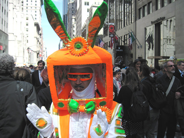 Old in New York the Easter Parade may be, but some of the costumes are truly out of this world